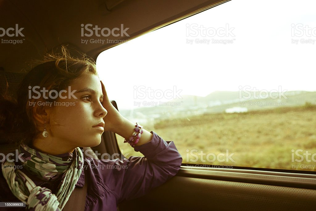 Teenager girl traveling by car stock photo