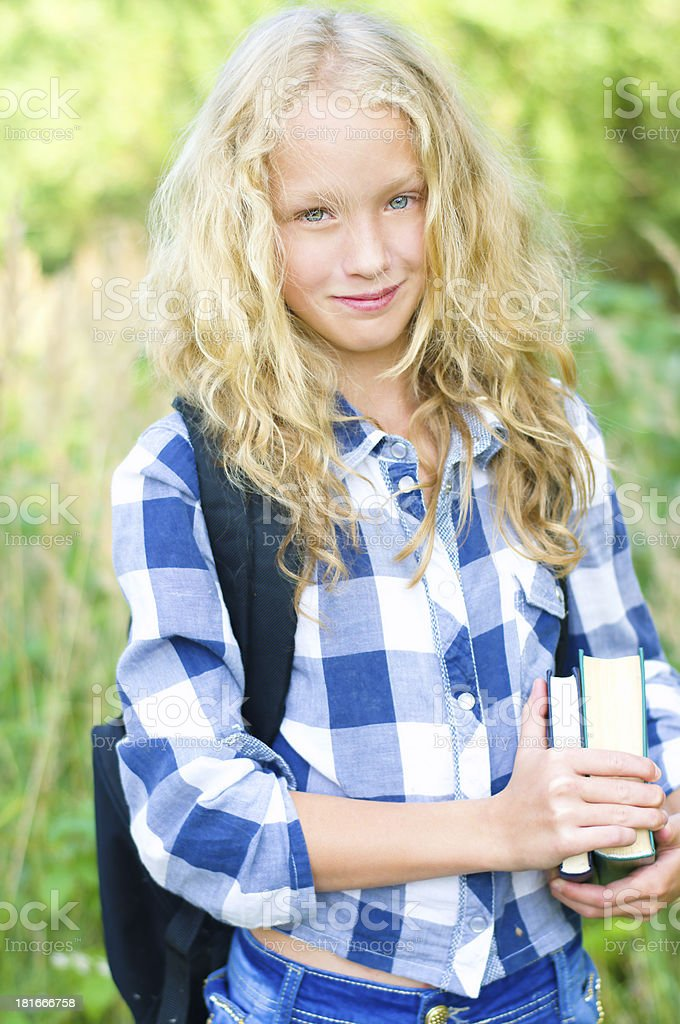 teenager girl with backpack and books royalty-free stock photo