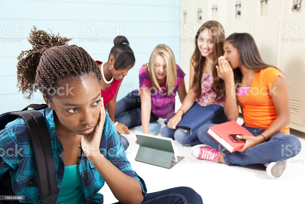 Teenager girls using internet technology. Cyber bully, harass classmate. School. stock photo