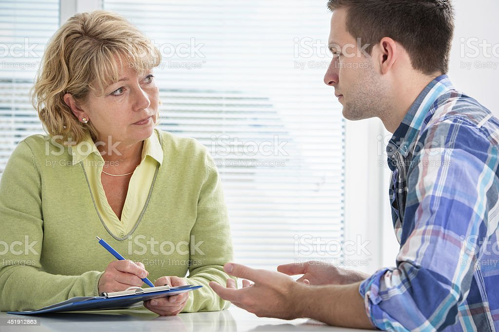 Teenager having a  therapy session stock photo