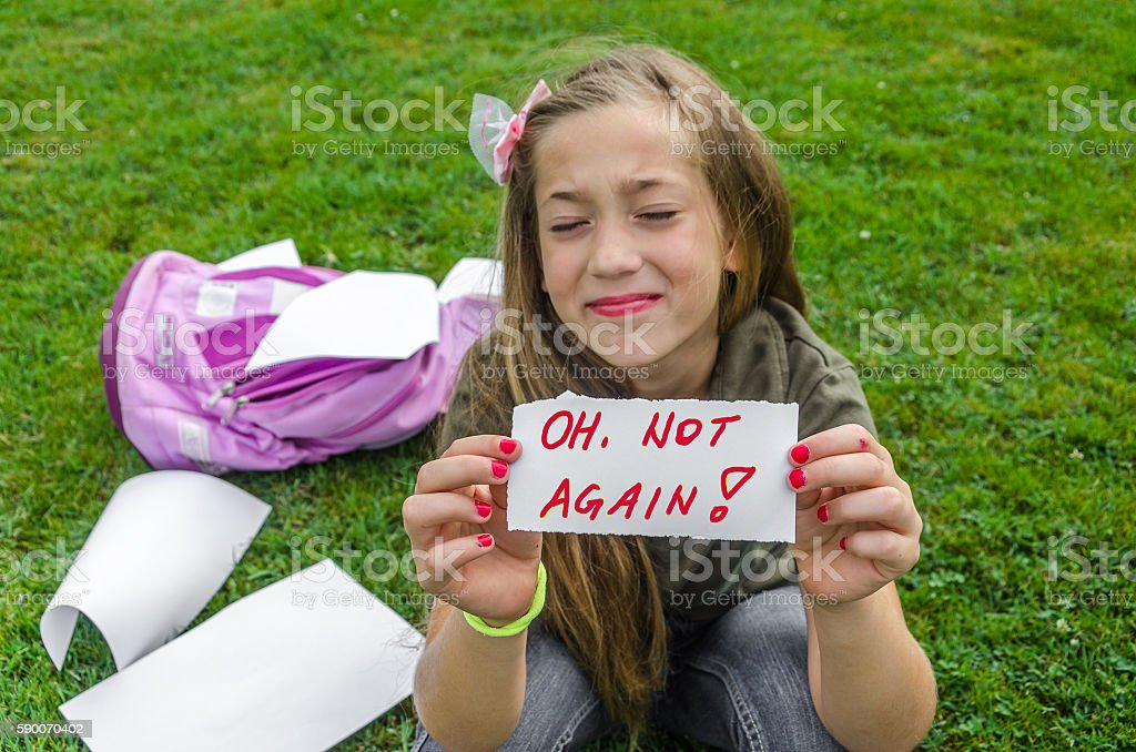 teenager holding a piece of paper with the inscription stock photo