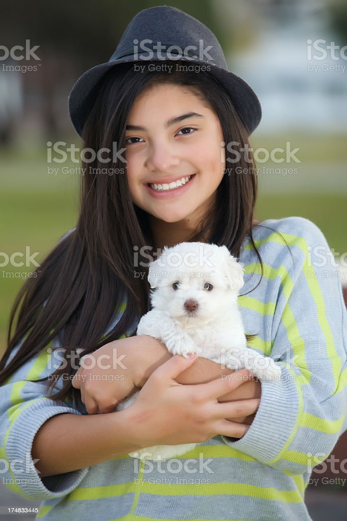 teenager holding a puppy royalty-free stock photo