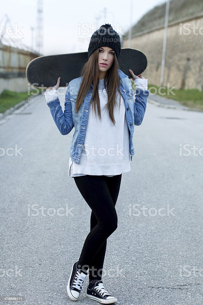 Teenager holding skateboard royalty-free stock photo