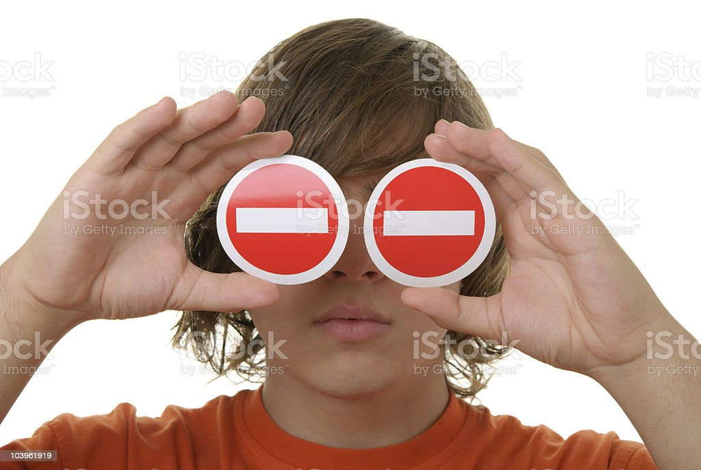 Teenager holds prohibiting signs before eyes stock photo