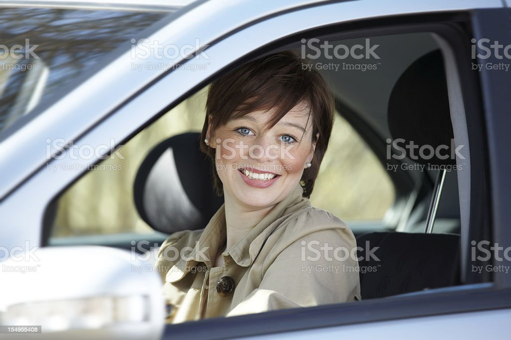 teenager in a car smiling at camera stock photo