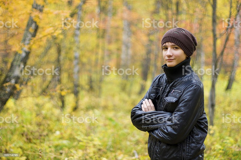 Teenager in autumn forest royalty-free stock photo