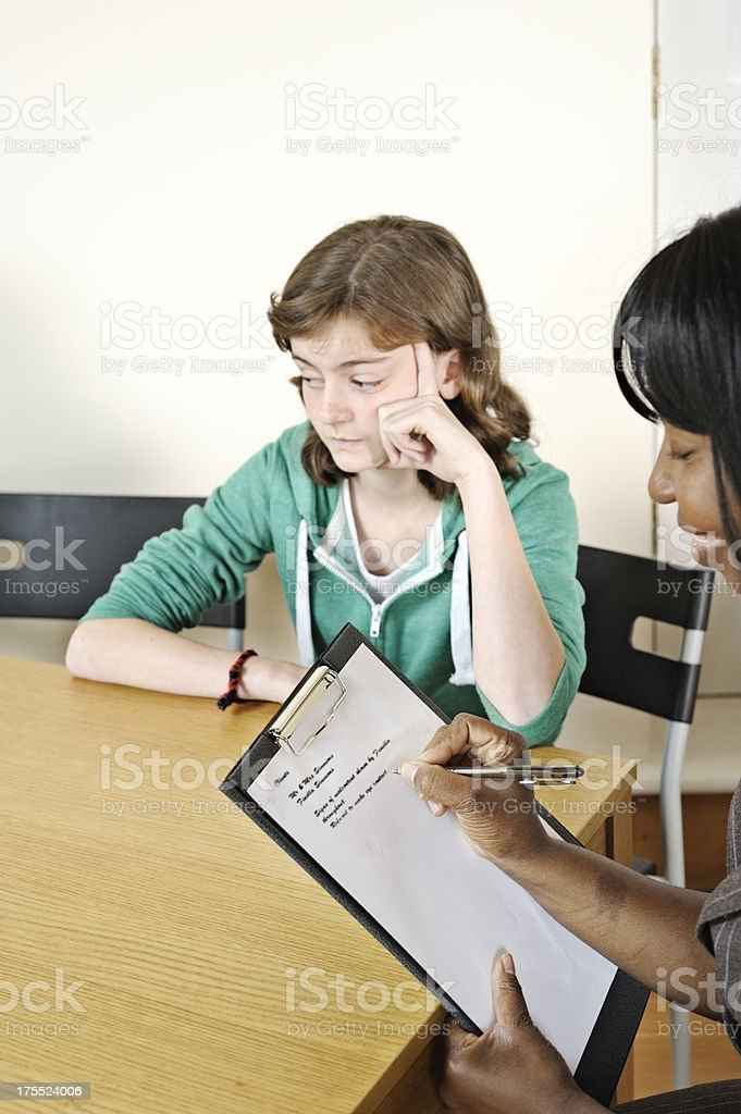 Teenager in counselling session royalty-free stock photo
