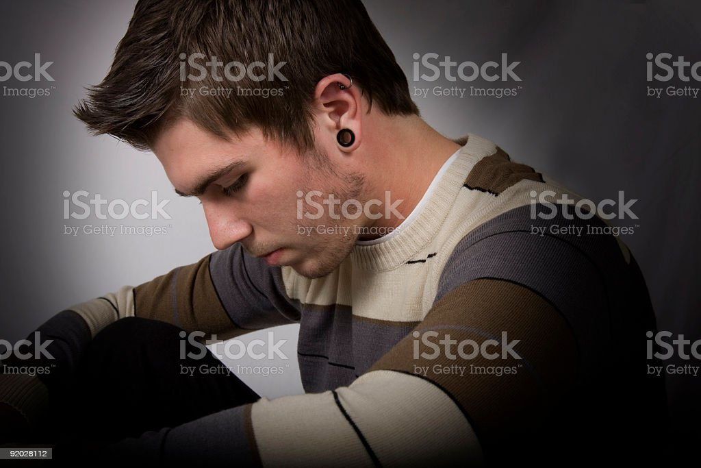 Teenager in deep thought (DEPRESSION SERIES) stock photo