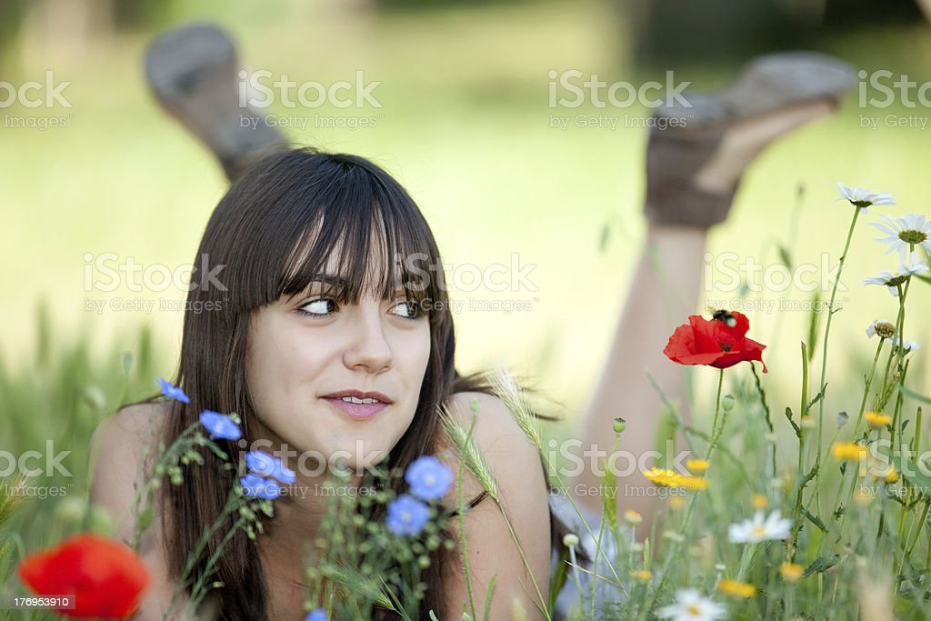 teenager in flowers royalty-free stock photo