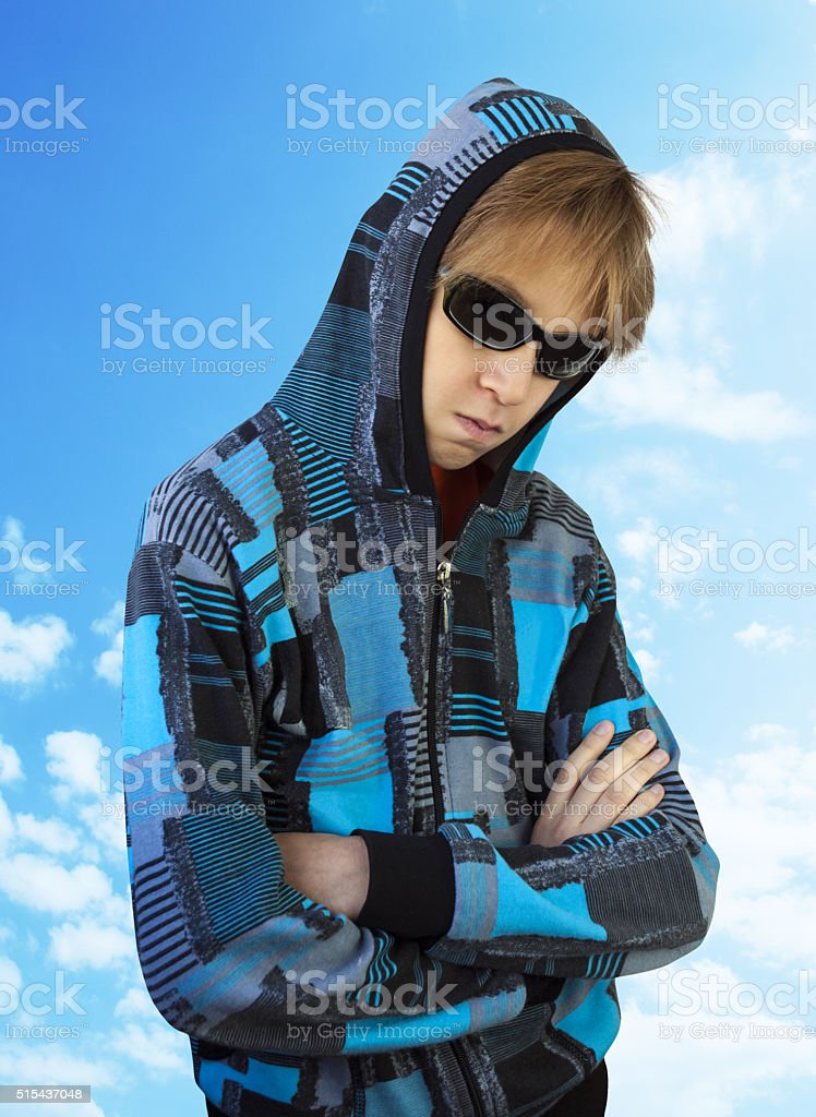 Teenager in glasses stock photo