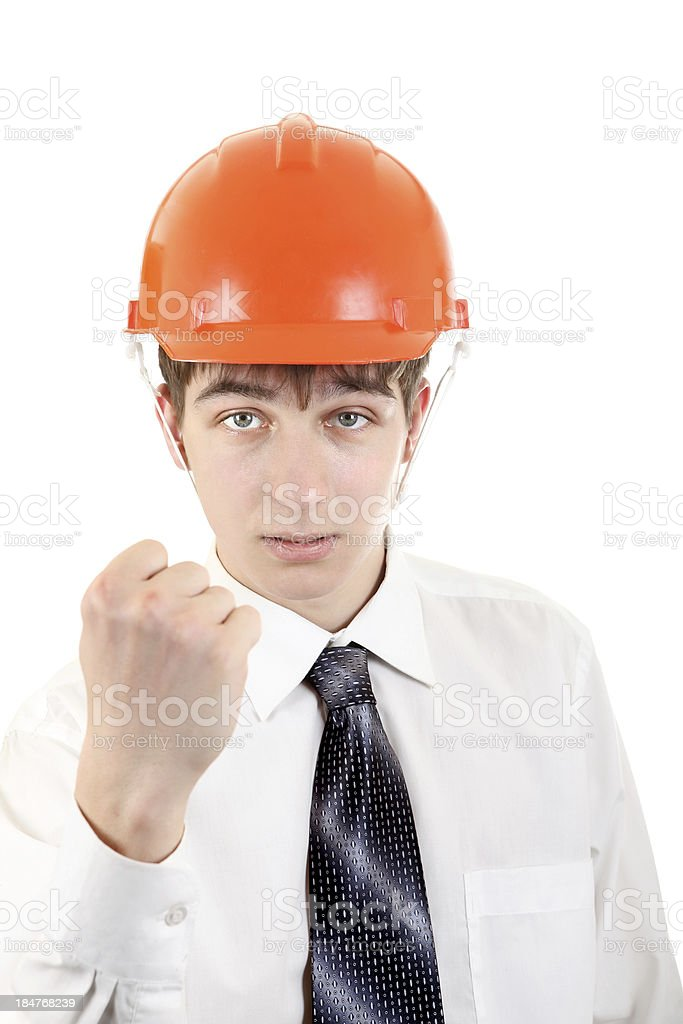 Teenager in Hard Hat showing his Fist royalty-free stock photo