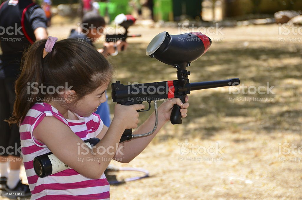 Teenager in target practice with a paintball gun stock photo