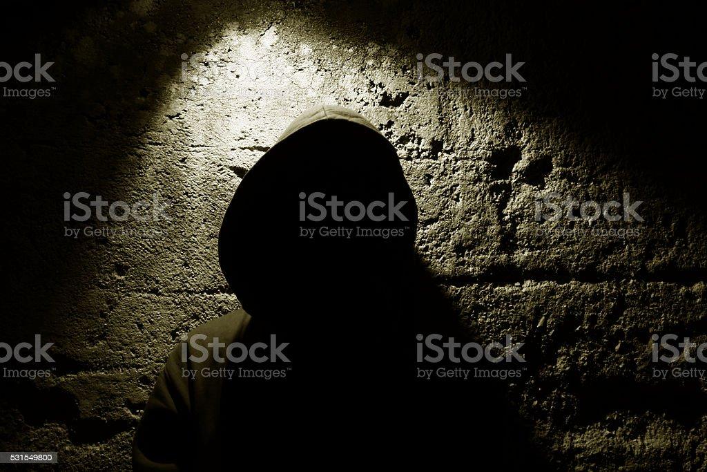 Teenager in the dark stock photo