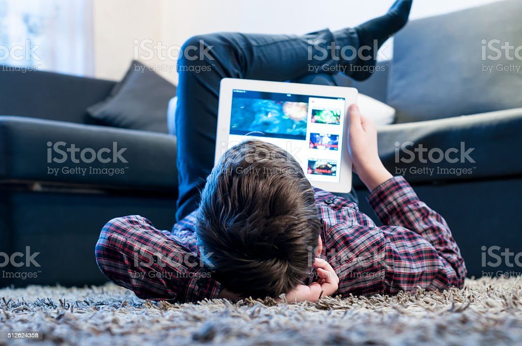 teenager lay on the floor in the room stock photo