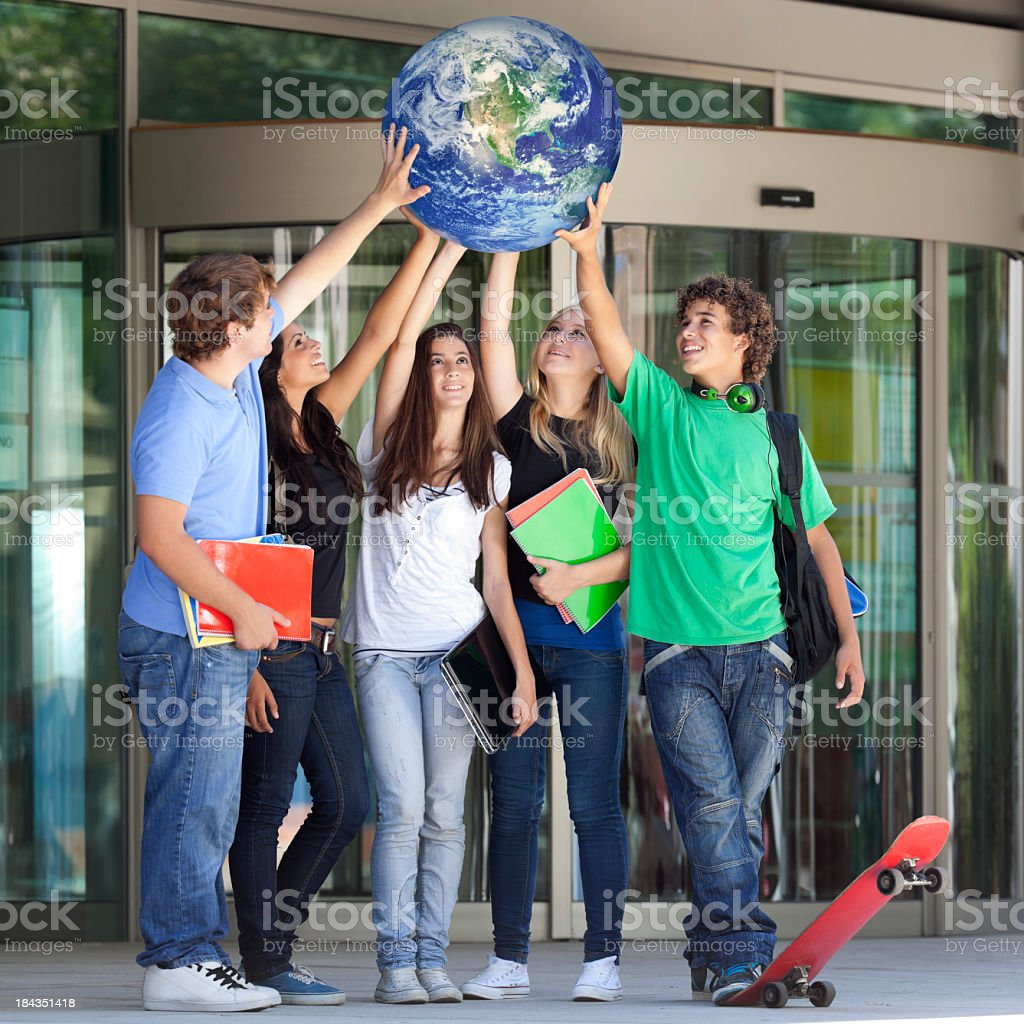 teenager lifting the world stock photo