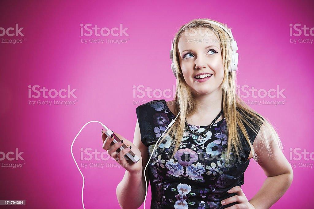 Teenager listening to music stock photo