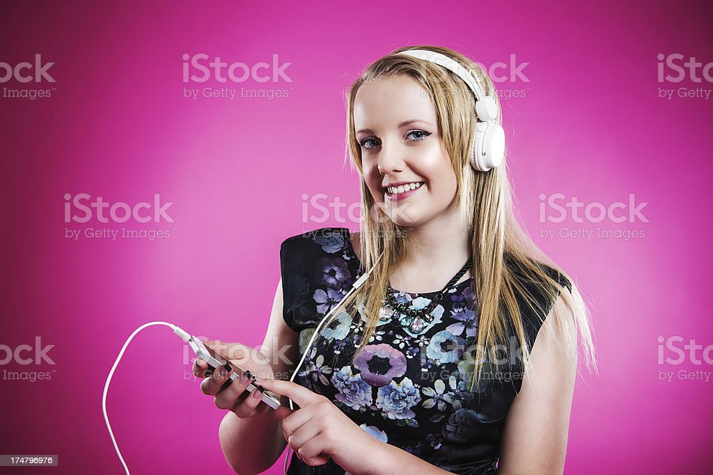 Teenager listening to music stock photo