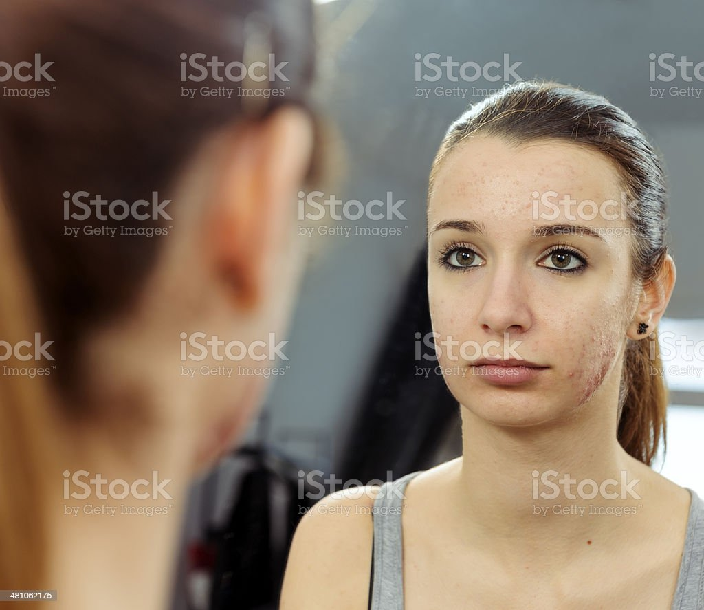 teenager looking in the mirror royalty-free stock photo