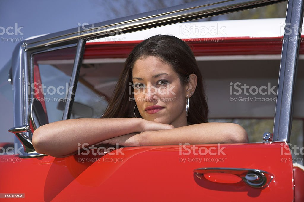 Teenager looking out a window royalty-free stock photo