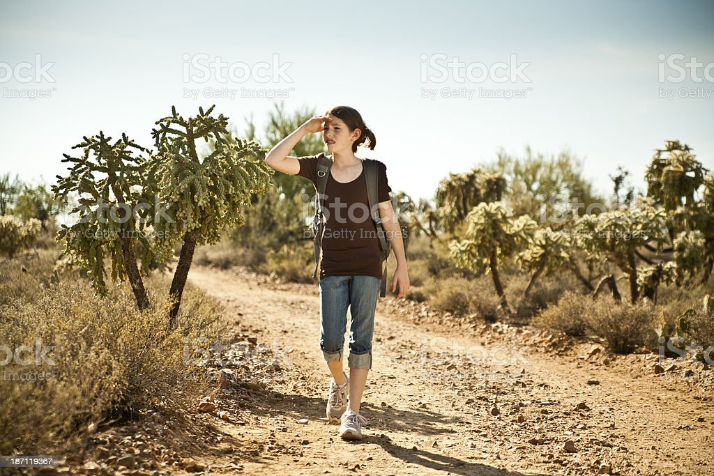 Teenager lost in the desert royalty-free stock photo