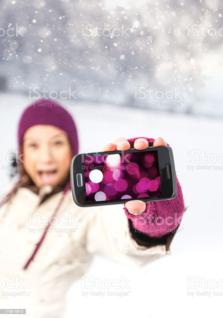 Teenager making fun with phone royalty-free stock photo