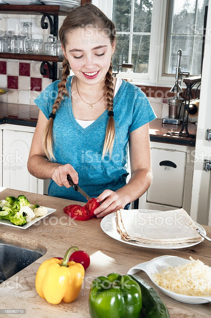 Teenager making healthy veggie pizza. royalty-free stock photo