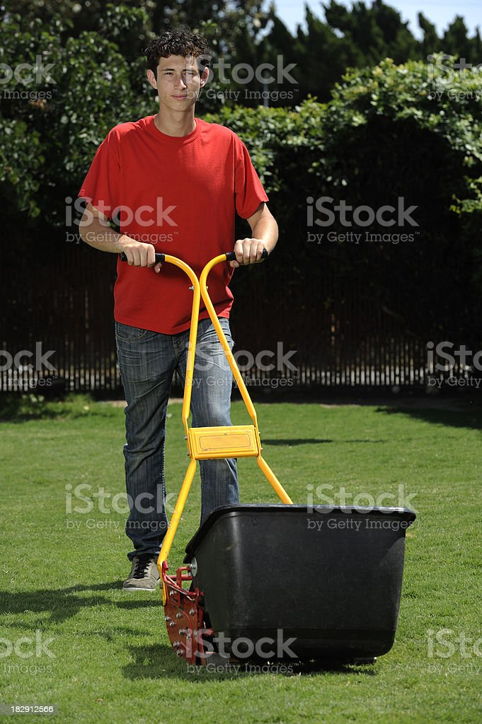 Teenager Mowing stock photo