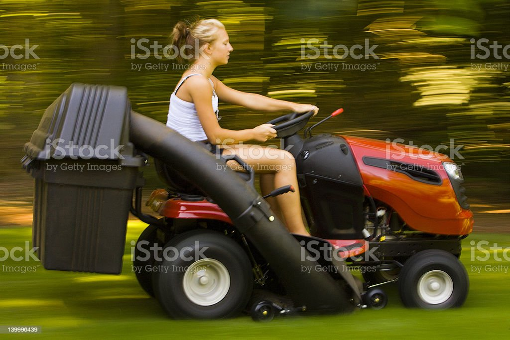 Teenager Mowing the Lawn stock photo