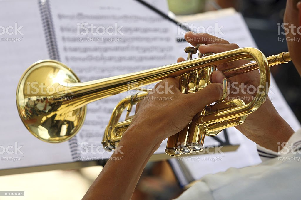 Teenager musician playing the trumpet stock photo