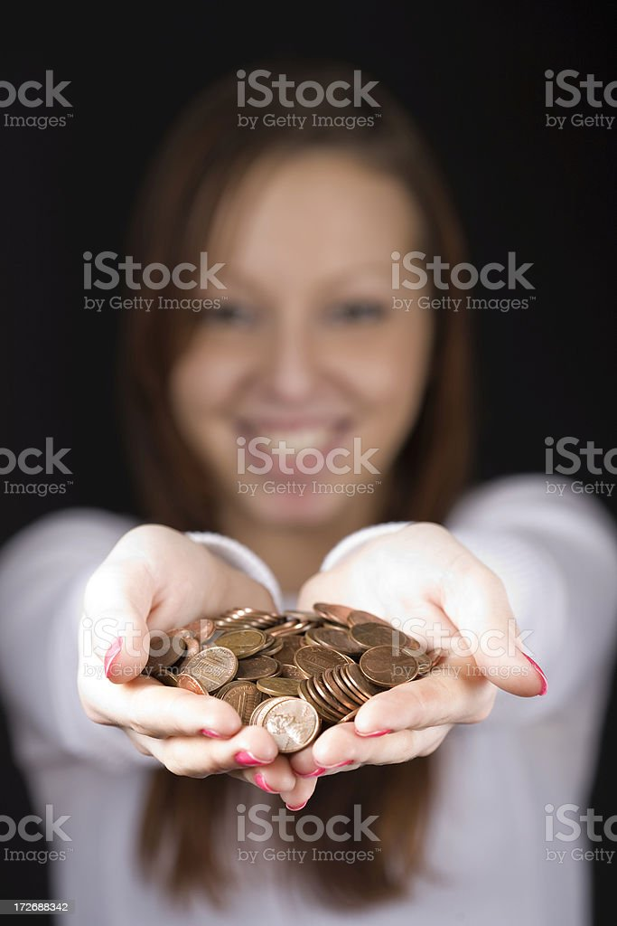 Teenager offering handfull of money royalty-free stock photo