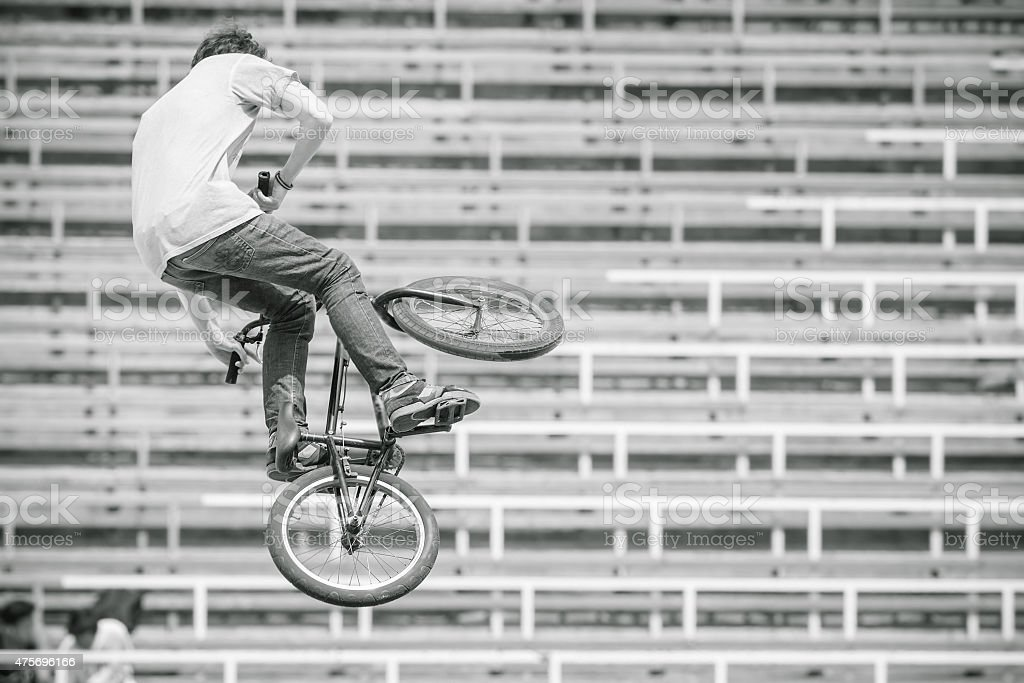 teenager on a bicycle in a high jump stock photo