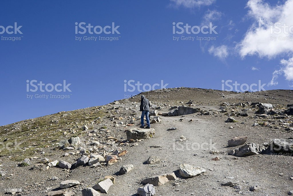 teenager on a footpath uphill royalty-free stock photo