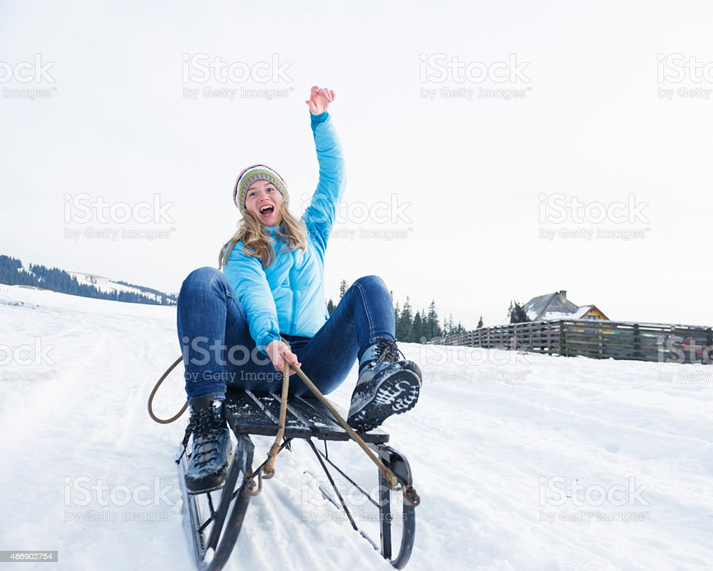 Teenager on sled having fun stock photo
