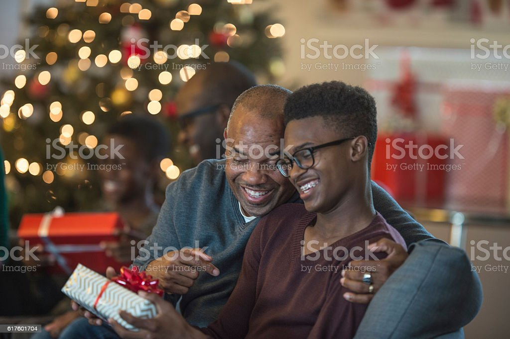 Teenager Opening a Present stock photo