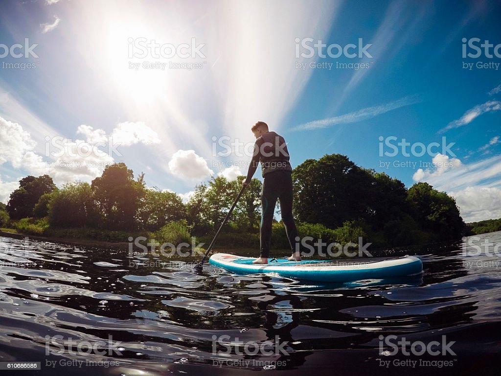 Teenager Paddleboarding stock photo