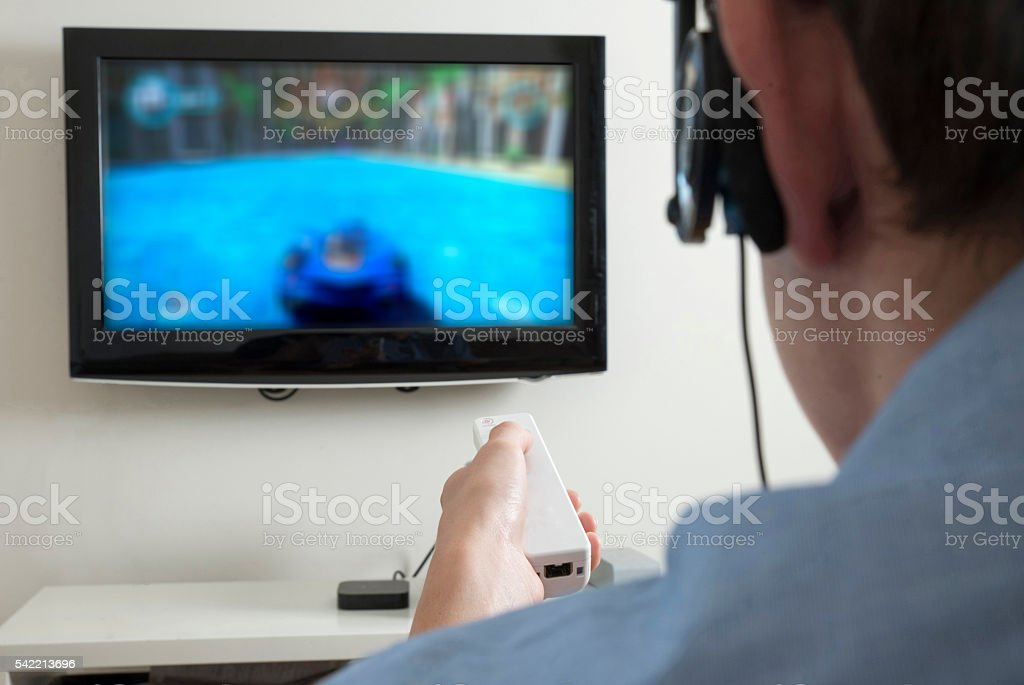 Teenager player on games console stock photo