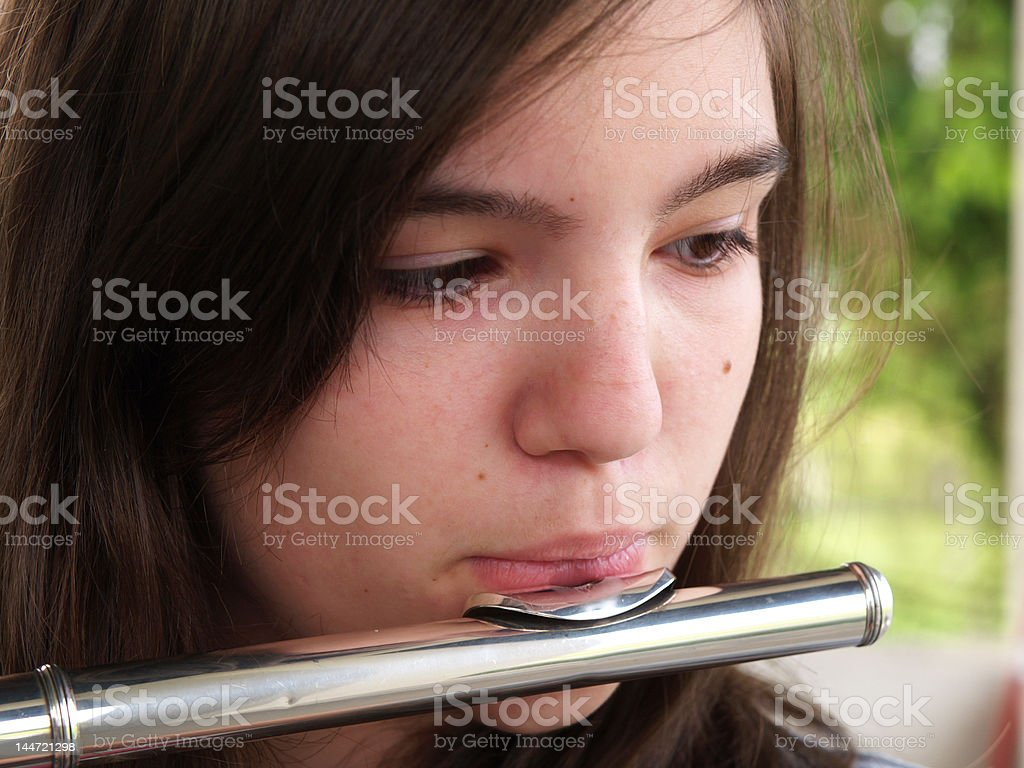 Young Talented Girl Practicing Flute Indoors Against White ...