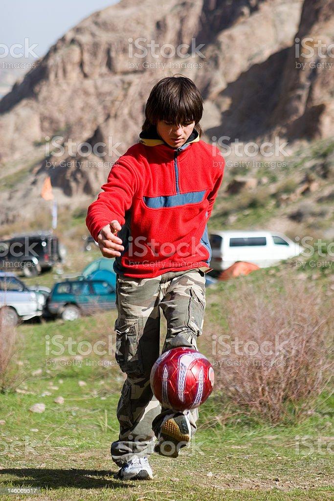 Teenager playing football royalty-free stock photo