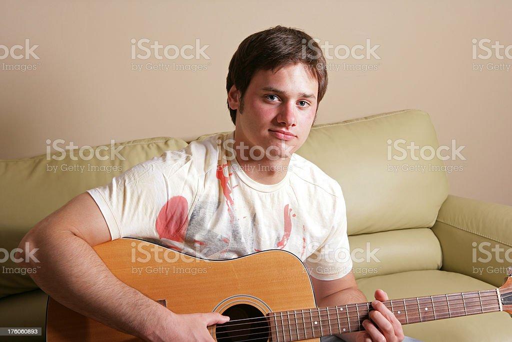 Teenager Playing Guitar royalty-free stock photo