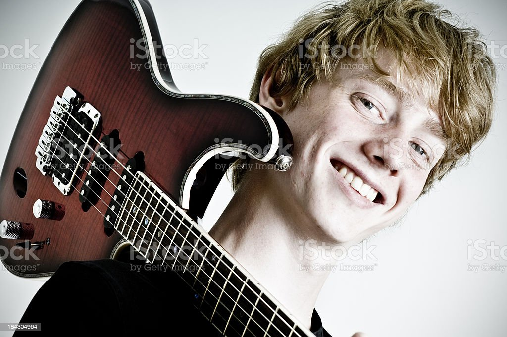 Teenager Playing Guitar royalty-free stock photo