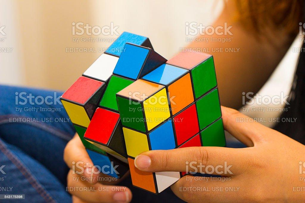 Teenager playing magic cube stock photo