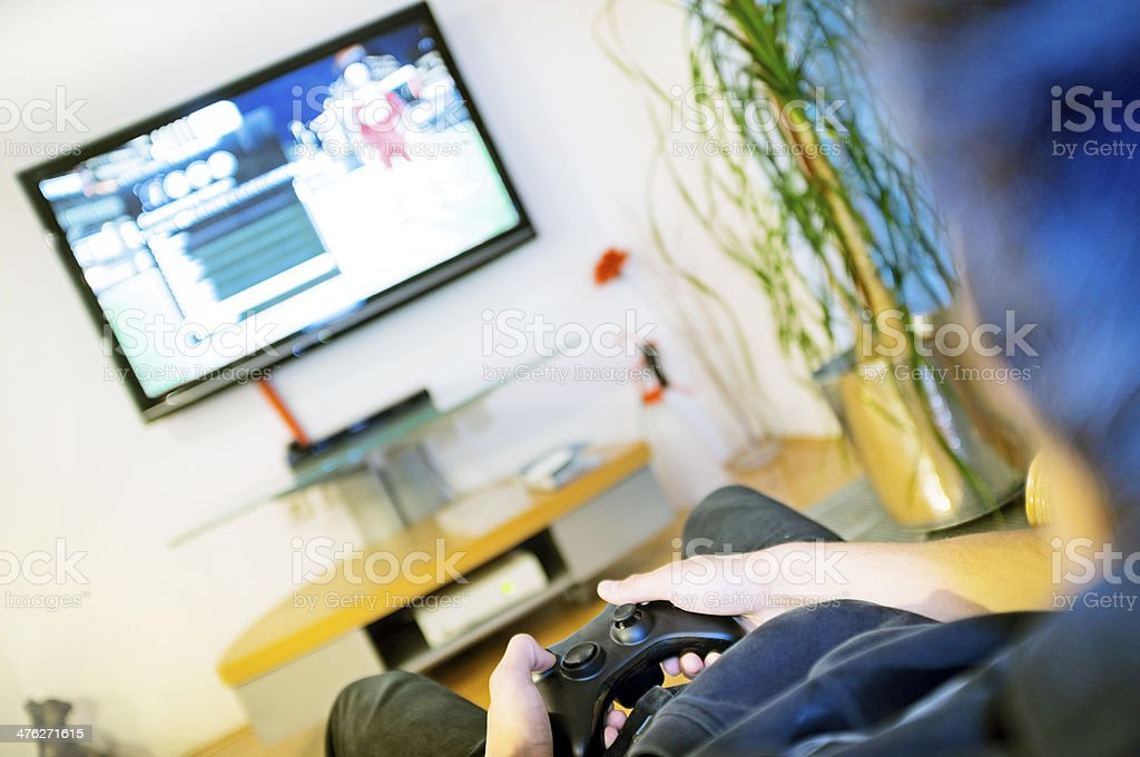Teenager Playing Video Game royalty-free stock photo