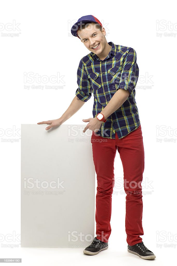 Teenager pointing at blank poster royalty-free stock photo