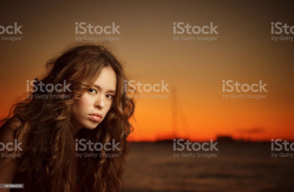 teenager portrait in the beach at sunset stock photo