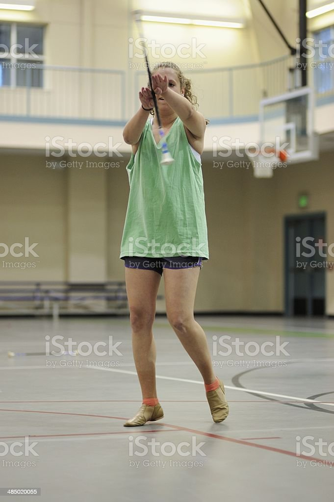 Teenager practicing fishtail baton twirling stock photo