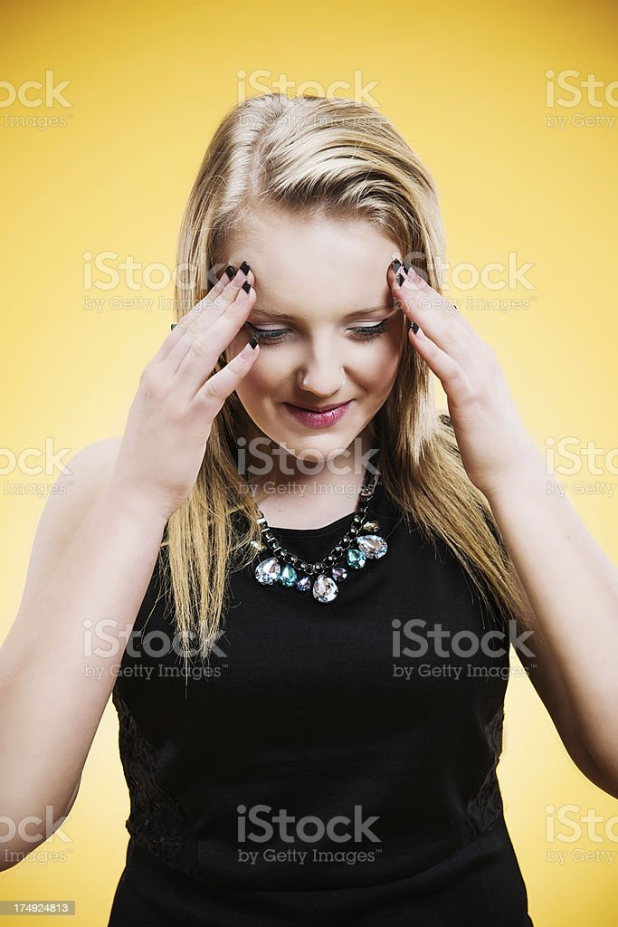 Teenager pressing hear head stock photo