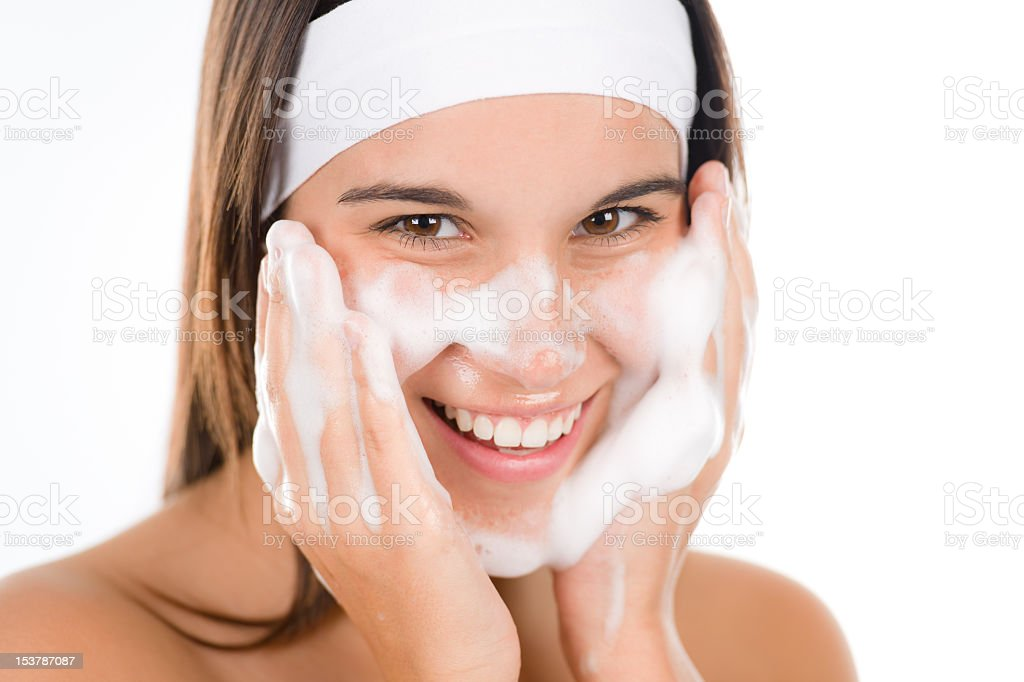 Teenager problem skin care - woman wash face stock photo