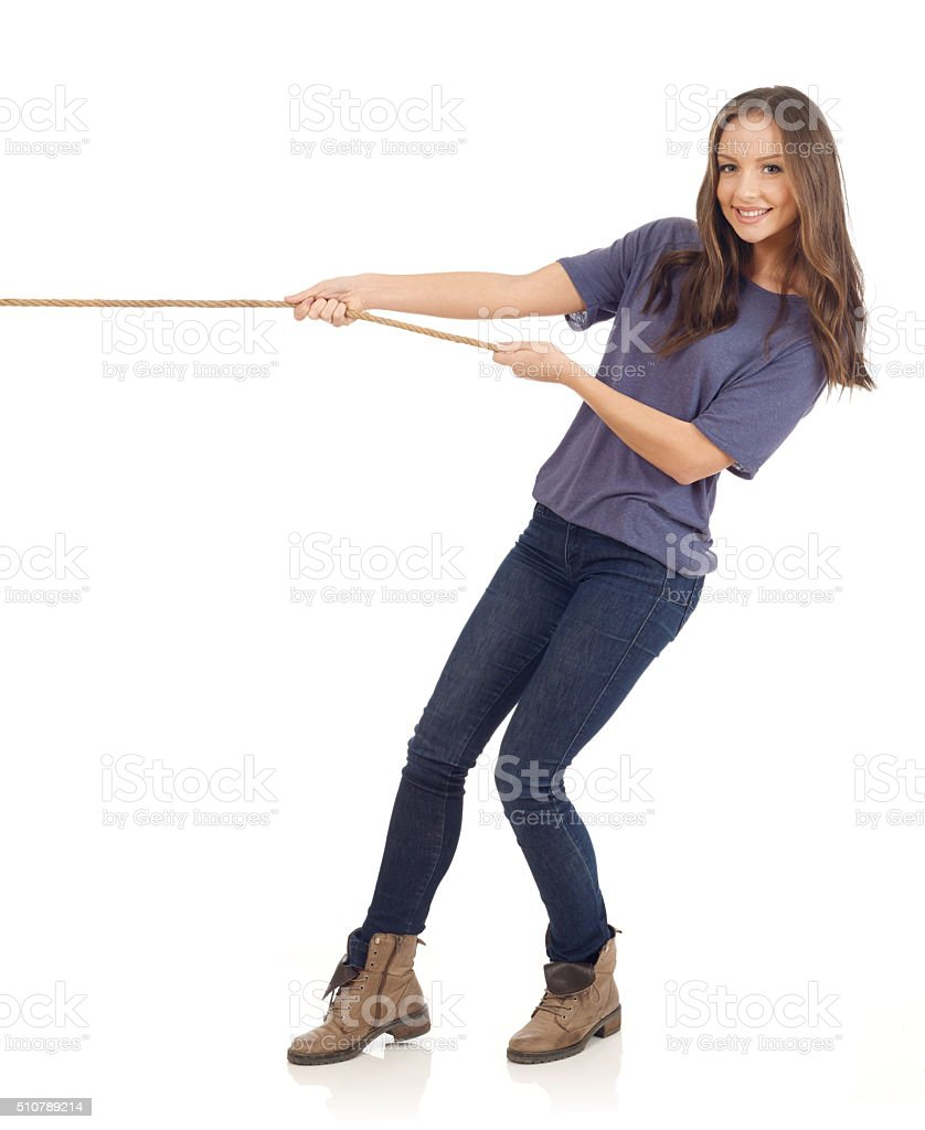 Teenager pulling a rope stock photo