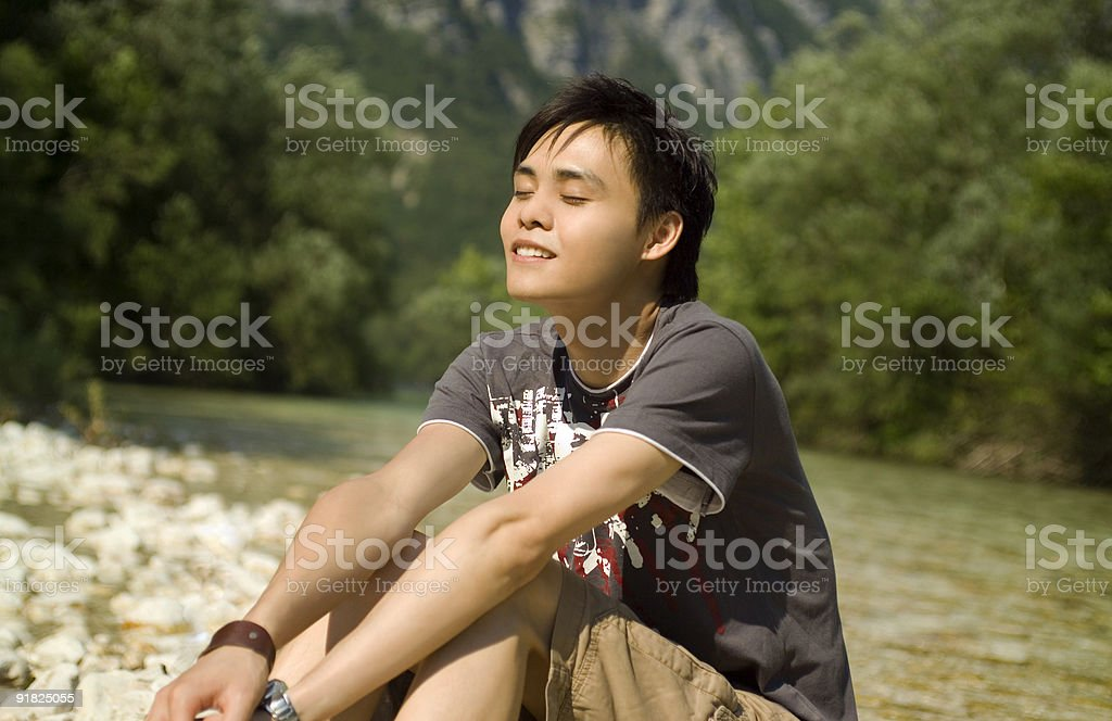 Teenager Relaxing By The River royalty-free stock photo