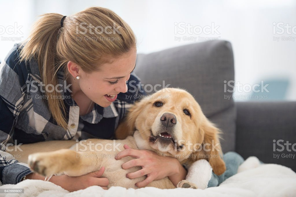 Teenager Relaxing with Her Dog stock photo